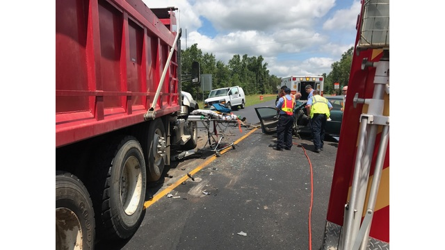 Highway 56 closed after accident involving car and dump truck