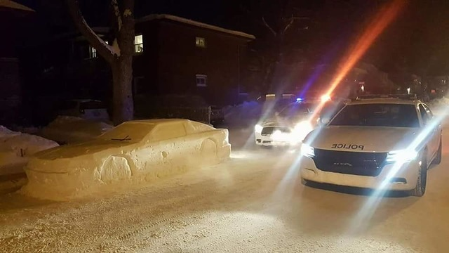 Montreal cop stops to ticket fake car made of snow