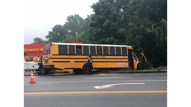 Bus overturned, no children involved, and driver injured in school bus accident